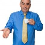 Man in blue shirt drinking coffee — Stock Photo #6440175