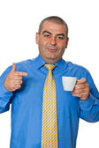 Man in blue shirt drinking coffee — Stock Photo