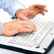 Men's hands on laptop keyboard large — Stock Photo