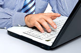 Men's hands on laptop keyboard large — Stock Photo
