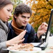Stock Photo: Couple sitting laptop park