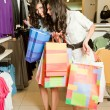 Twin females shopping — Stock Photo