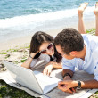 Couple laptop beach — Stock Photo