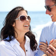 Couple holding hands beach — Stock Photo #6373900