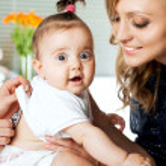 Baby examination mother — Stock Photo