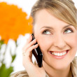 Woman talking on cell phone — Stock Photo #6373944