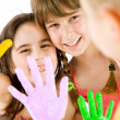 Stock Photo: Children painted hands playing