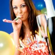 Woman celebrating birthday - Stock Photo
