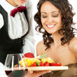 Stock Photo: Waitress offering fruits to customer