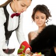 Waitress serving to beautiful female — Stockfoto
