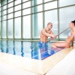 Flirting couple swimming pool — Stock Photo