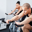 Man spinning veloargometer gym — Stock Photo #6374292