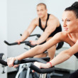 Stock Photo: Female veloargonometer gym