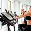 Young athletic couple gym — Stock Photo #6374301