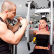 Female in the gym with trainer - Stock Photo