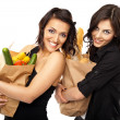 Stock Photo: Two women holding groceries