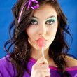 Stock Photo: Woman licking lollipop