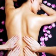 Lower back massage - Stock Photo