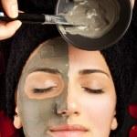 Applying facial mask — Stock Photo