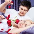 Love romantic couple bed - Stock Photo