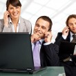 Stock Photo: Successful team phones and laptop