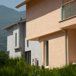 Modern houses by the mountain — Stock Photo