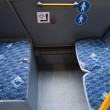 Empty seats in a public buss - Stock Photo