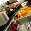 Batter fried in a restaurant kitchen — Stock Photo