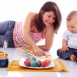 Mother and child with Easter eggs — Stock Photo