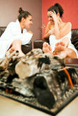 Females fireplace gossip — Stock Photo