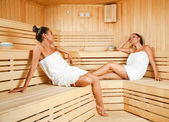 Females relaxing in sauna — Stock Photo