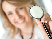 Stethoscope smiling doctor — Stock Photo