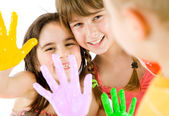 Children painted hands playing — Stock Photo