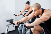Man spinning veloargometer gym — Stock Photo