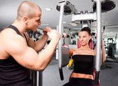 Female in the gym with trainer — Stock Photo
