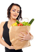 Woman holding grocery bag — Stock Photo
