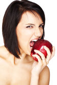 Girl biting an apple — Stock Photo