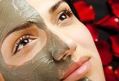 Female facial clay mask — Stock Photo