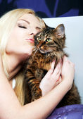 Woman kissing cat — Stock Photo