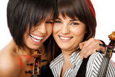 Cheek to cheek smiling violinists — Stockfoto