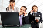 Successful team phones and laptop — Stock Photo