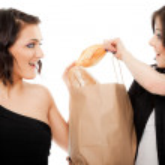 Girlfriends fighting over baguette — Stock Photo #6405918