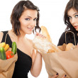Females holding shooping bags groceries — Stock Photo