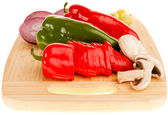 Vegetables on wooden board — Stock Photo