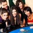 Young behind black jack table — Stock Photo