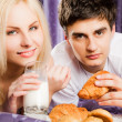 Couple breakfast bed milk moustache - Stock Photo