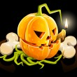 Royalty-Free Stock : Pumpkin with skeleton bone on black background