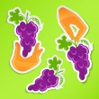 Sticker with hand holding grapes — Stock Vector