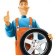 Auto mechanic with wheel — Image vectorielle