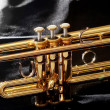 Gold trumpet in night - Stock Photo